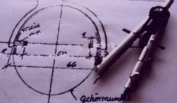 Measuring quality—image of drawing compass and technical drawing