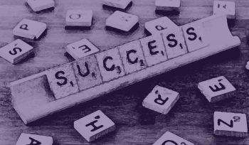 Scrabble tiles spelling out success—representing business plan success