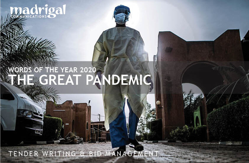 Image of nurse in developing nation with headline—WORDS OF THE YEAR 2020 THE GREAT PANDEMIC